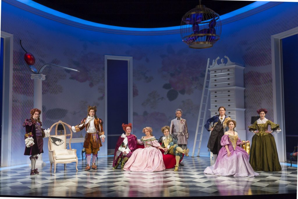 The full cast of The School For Lies and the French lush life parlor designed by Alexander Dodge.