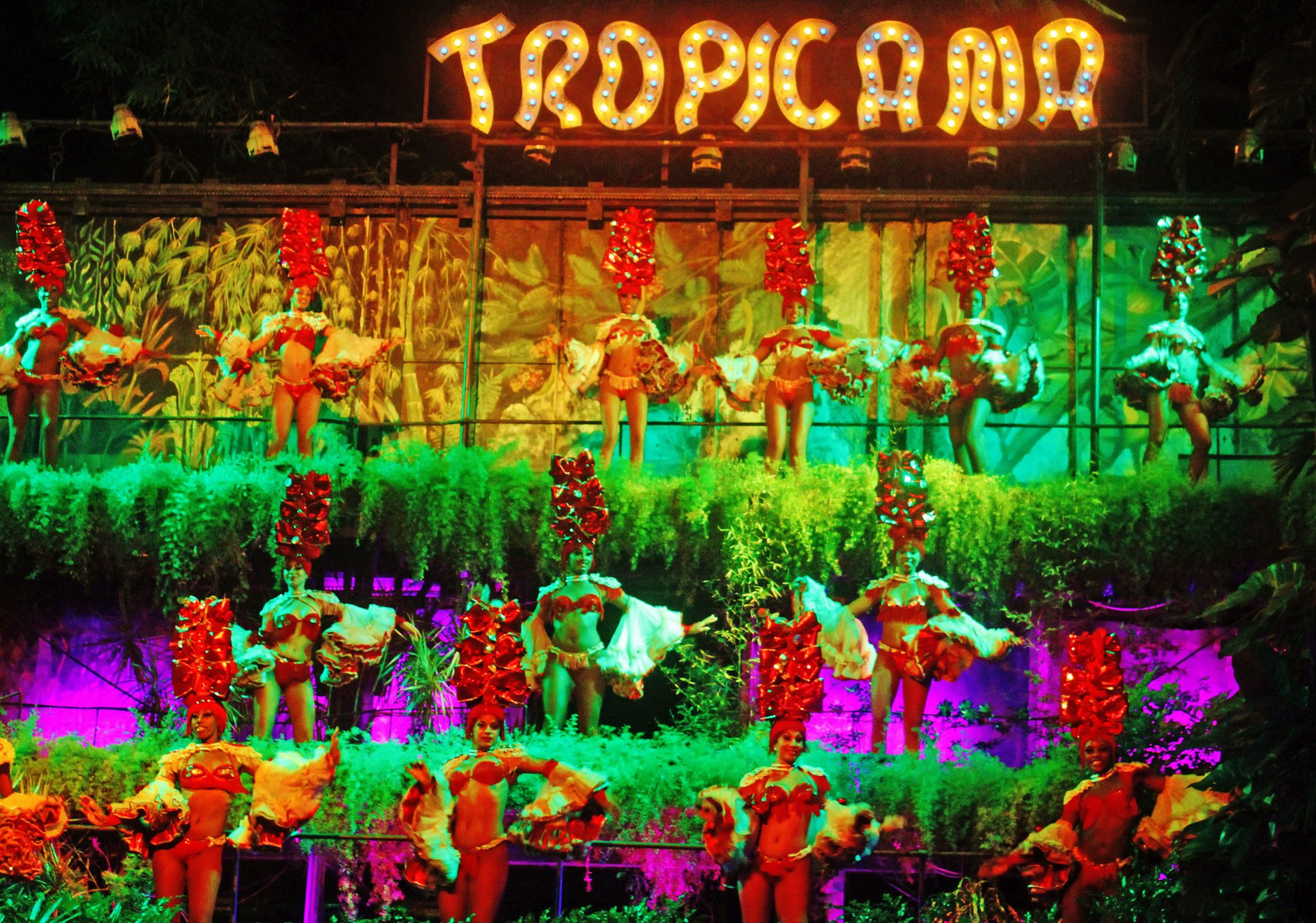 The Tropicana is a lush three tiered tropical garden setting that showcases over 100 dancers and performers on three sides of a grand ballroom sized center stage.