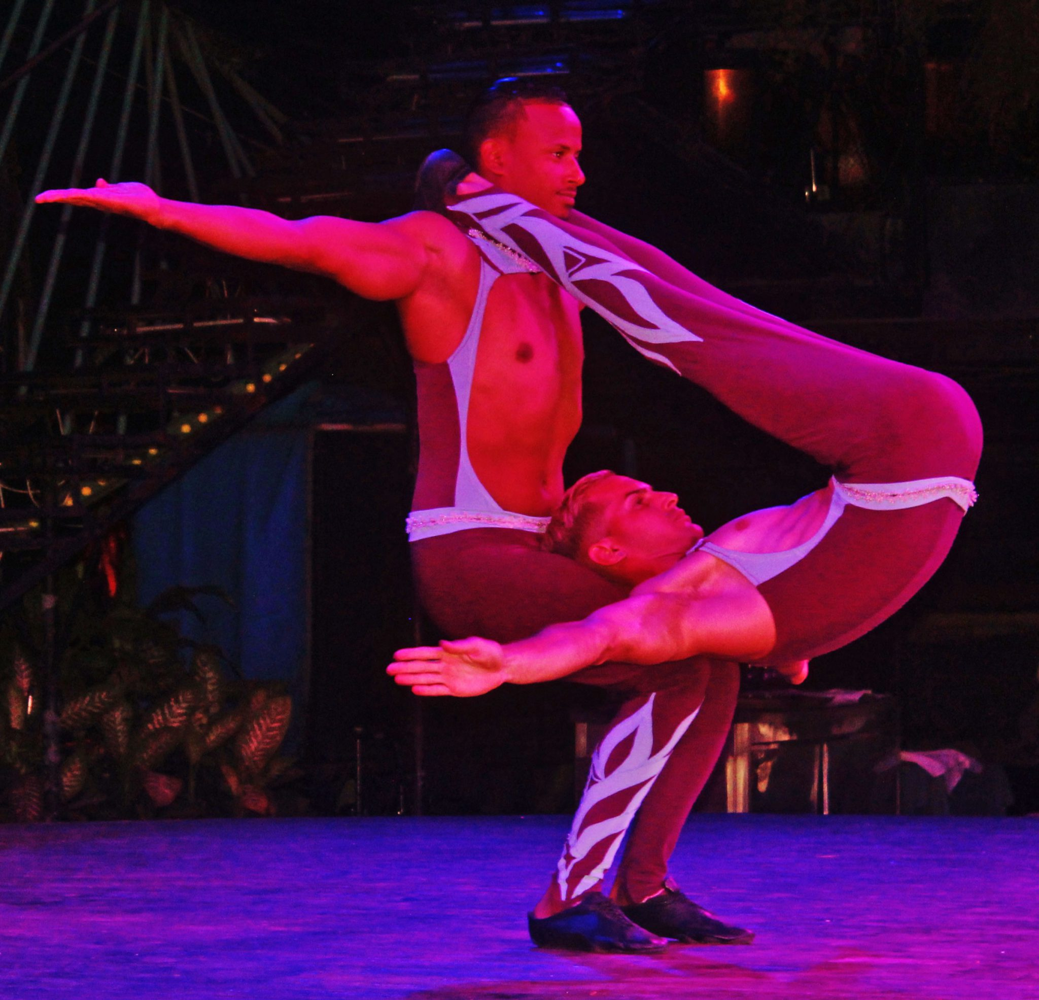 The power and grace of these two acrobats sent a hush over the Tropicana in an unexpected display of near Olympic quality strength and endurance.